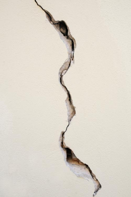 Attaching repairing and hanging things on plaster walls How to fill a crack in the wall